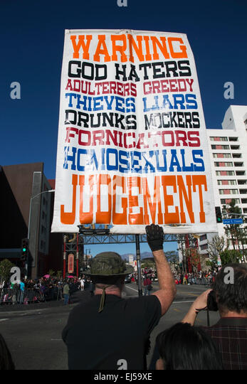 Sign for Christian extremist, anti-homosexual and atheists, hold sign, Chinese New Year, Los Angeles, California, - Stock-Bilder