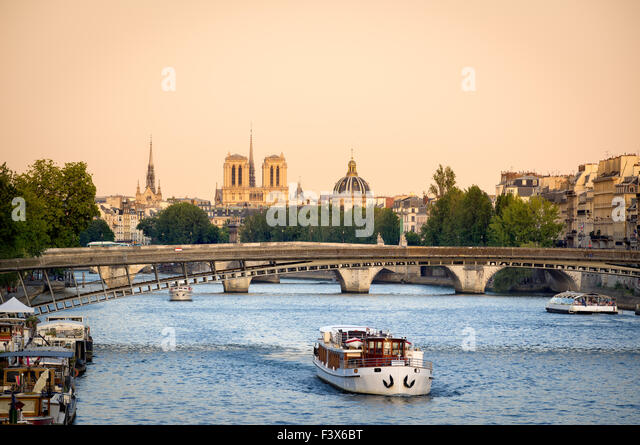Seine River in Paris with Passerelle de Solferino bridge. In the distance, Notre Dame Cathedral and Institut de - Stock Image