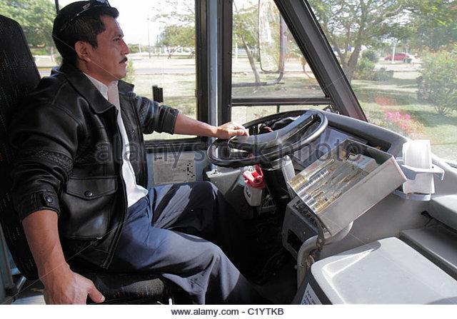 Cancun Mexico Yucatán Peninsula Quintana Roo Avenida Tulum Hispanic man bus driver public transportation job - Stock Image