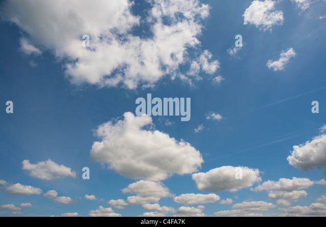 Blue sky with fluffy clouds - Stock Image