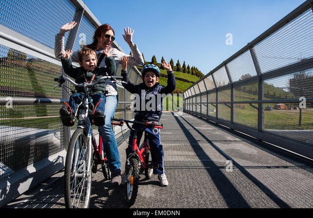 Modern steel cycle bridge that connects the city park - Stock Image