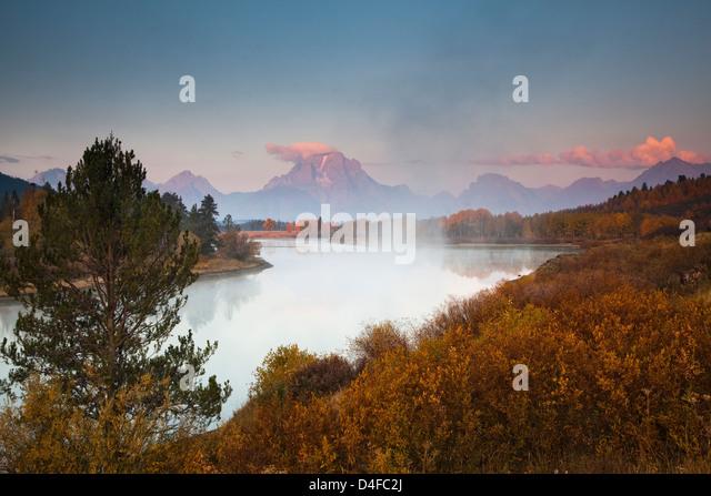 Mist over river in rural landscape - Stock Image