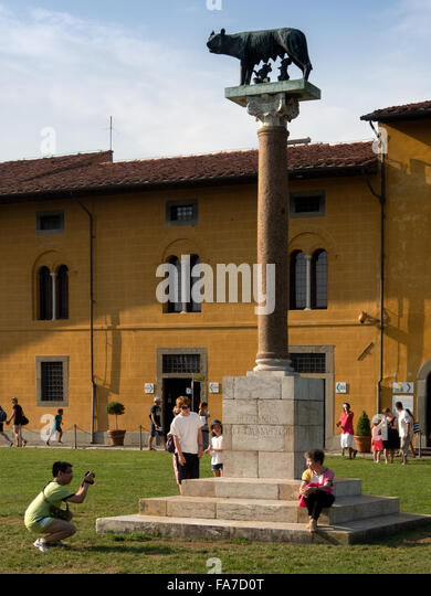 Statue of Romulus and Remus suckling on the wolf in the Plaza of Miracles, Pisa - Stock Image