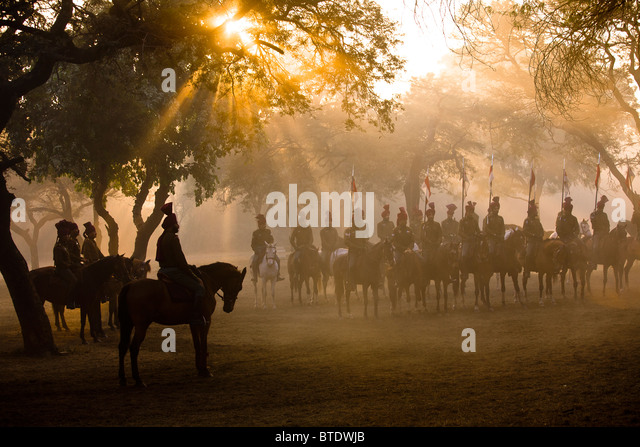 Presidential Bodyguard soldiers in early morning dust and mist filled horsemanship practice, consisting of jumping, - Stock Image