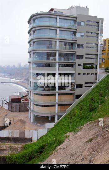 Lima Peru Barranco District Malecon Pacific Ocean coast cliff apartments flats multi family housing building exterior - Stock Image