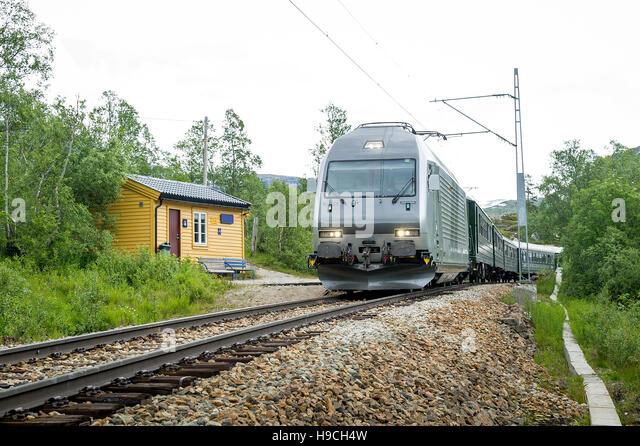 Flamsbana railway train arriving at small rural station, Norway. - Stock Image