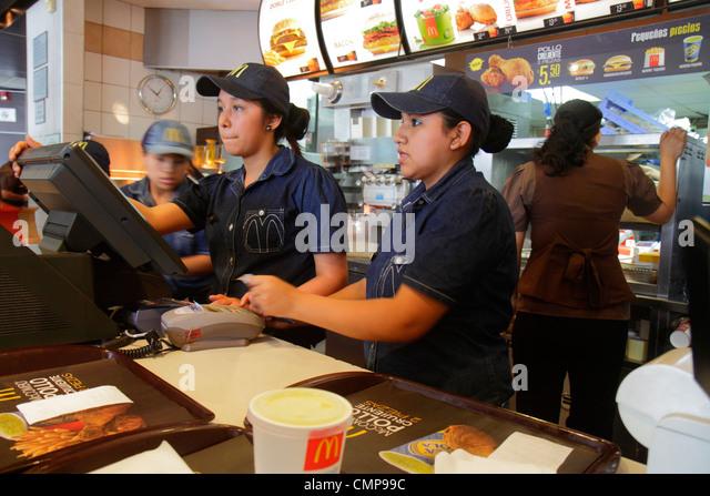 Lima Peru Surquillo Avenida Ricardo Palma McDonald's restaurant American chain fast food hamburger counter cashier - Stock Image