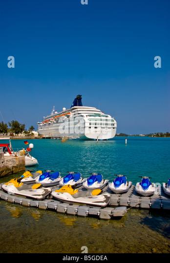 st george bermuda jet skis personal watercraft cruise ship at dock green water blue sky nobody - Stock Image