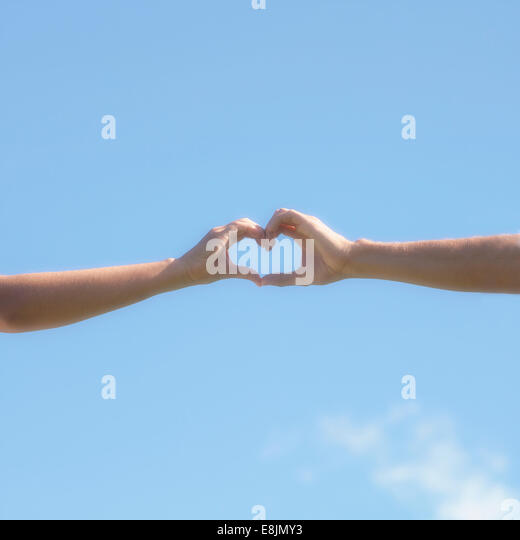 two hands forming a heart - Stock-Bilder