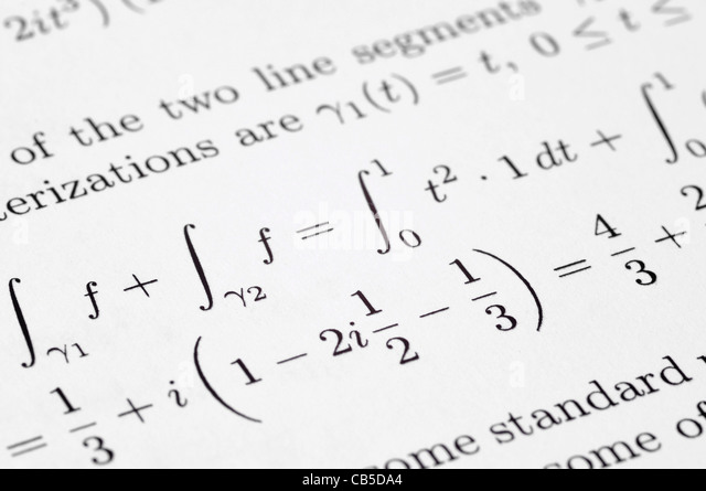 Mathematical equations on a school paper - Stock Image