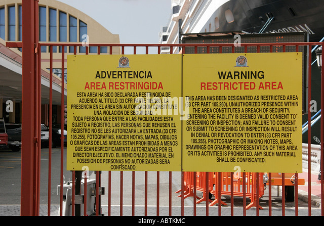 Puerto Rico San Juan Cruise Ship Port sign restricted area warning Spanish English language - Stock Image