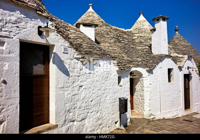 Alberobello, Apulia, Italy. A trullo (plural, trulli) is a traditional Apulian dry stone hut with a conical roof. - Stock Image
