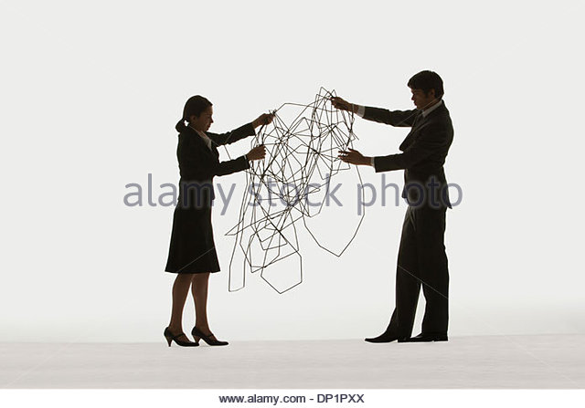Two businesspeople holding a cable - Stock Image