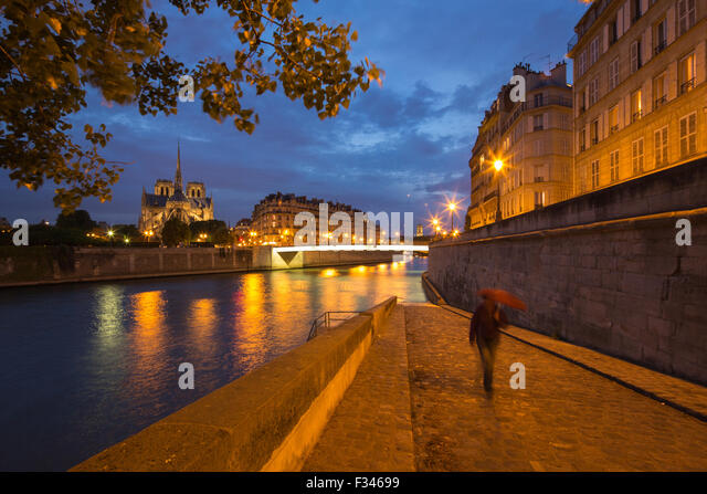 Notre-Dame Cathedral and the Île de la Cité from Ile St Louis at night, Paris, France - Stock Image