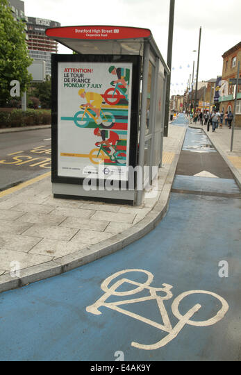 London, UK. 07th July, 2014. A bus shelter on Stratford High Street with a Tour de France poster. Credit:  Credit: - Stock Image