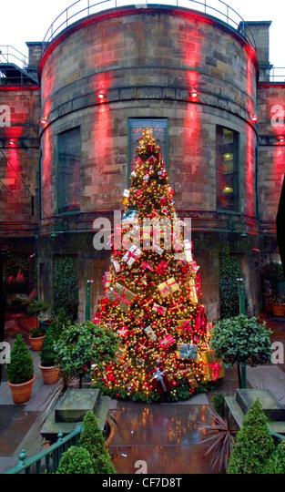 Dome Club Christmas tree, Edinburgh, Scotland in red, lit by lights - Stock Image
