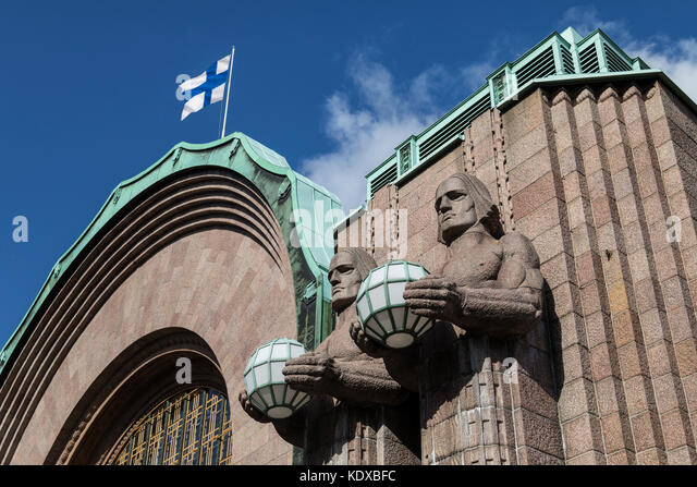 Helsinki - Finland. Art Deco figures at the main entrance to the central Railway Station. - Stock Image