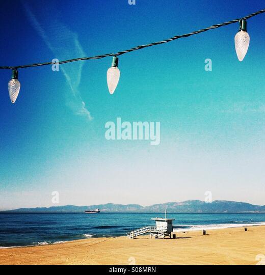 Holiday lights hanging on the Manhattan beach pier. Manhattan Beach, California USA. - Stock Image