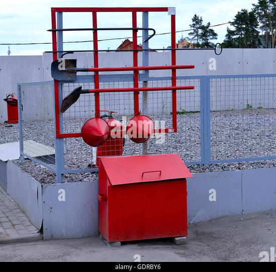 Fire Shield on the wall. Set primary fire extinguishing equipment. - Stock Image