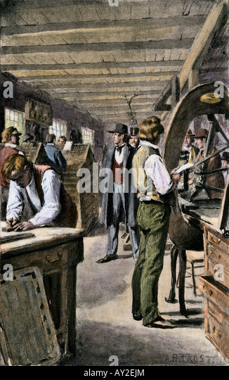 Typesetters and printers at work in a print shop 1800s - Stock Image