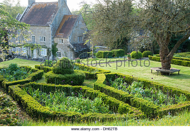 Parterre planted with alliums, foxgloves and delphiniums. Job's Mill, Crockerton, Wiltshire, UK - Stock Image