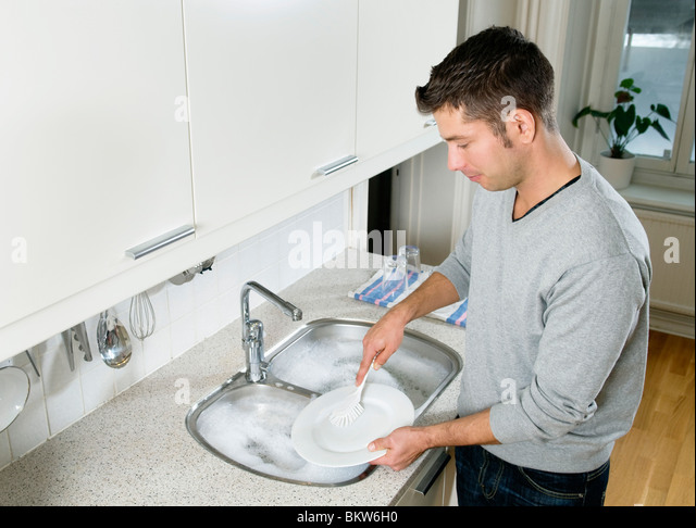 Young man cleaning - Stock-Bilder
