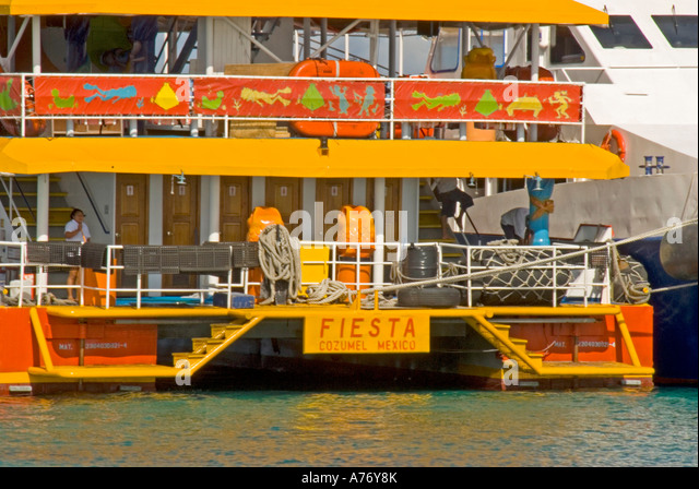 Cozumel Mexico San Miguel town party boat at dock - Stock Image