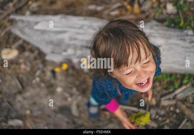 Elevated view girl laughing - Stock Image