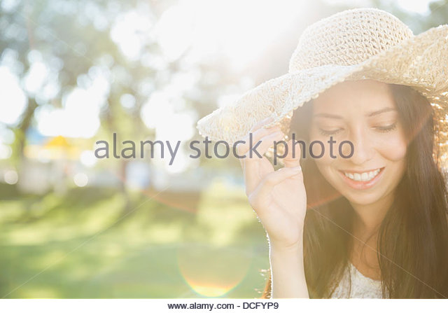 Portrait of teen wearing hat outdoors - Stock Image