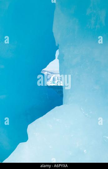 Ice formations on stranded icebergs at Akernerpaq, Angmagssalik Island, Sermilik Fjord, East Greenland - Stock Image