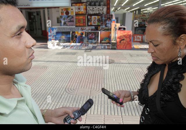 Santo Domingo Dominican Republic Ciudad Colonial Calle el Conde Peatonal Hispanic mestizo man woman adult passing - Stock Image