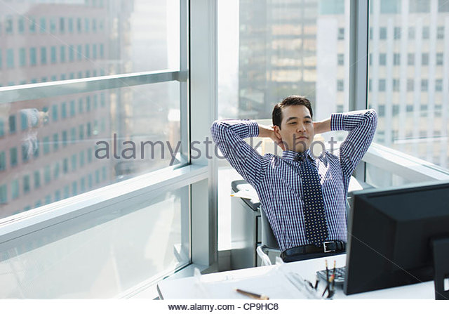 30-34 years,arms raised,asian ethnicity,black hair,business,business attire,businessman,california,city life,color - Stock Image