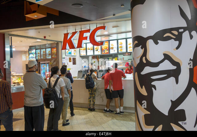 Melbourne Australia Victoria Central Business District CBD Central Station KFC fast food restaurant tables customers - Stock Image