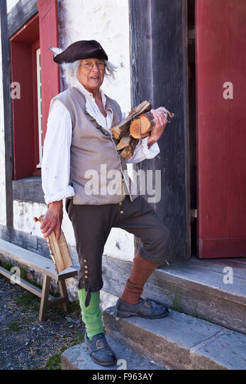 Elderly man in period costume in a reenactment of everyday life in18th Century Fortress of Louisbourg. He is portaying - Stock-Bilder