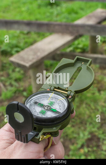 Lensatic compass - metaphor for business 'direction', navigation, moral compass, getting your bearings concept, - Stock Image