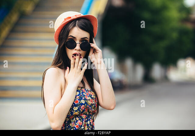 beautiful girl poses for camera in the city - Stock-Bilder