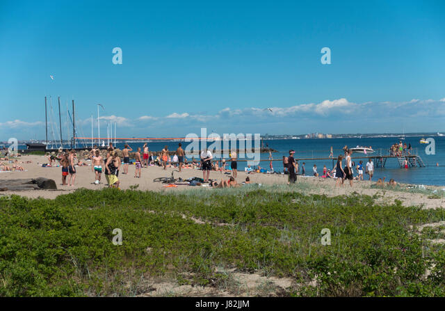 Beach at Espergærde, Espergaerde, near Elsinore on the coastal road to Copenhagen on the first summer day. - Stock Image