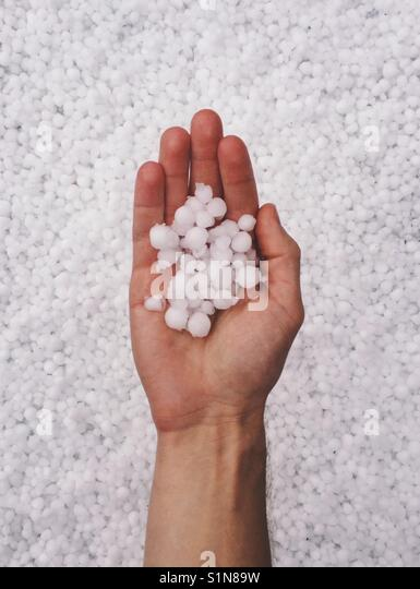 Hail Storm in Hand - Stock Image