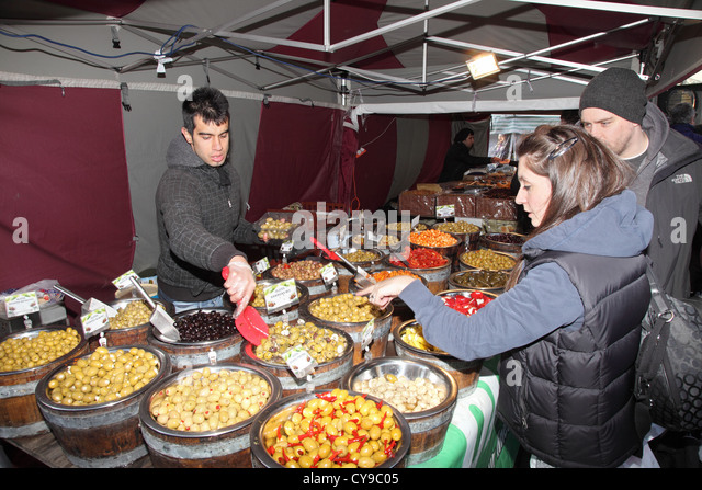 Italian man serving olives to customers at Durham City food festival, north east England, UK - Stock Image
