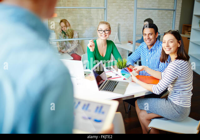 Young designers choosing a new color for interior - Stock Image