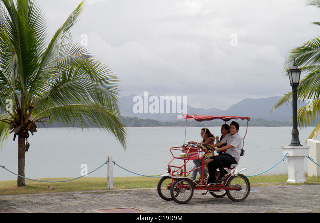 Panama City Panama Amador Causeway Calzada de Amador Bahia de Panama Panama Canal recreation area touring quadricycle - Stock Image