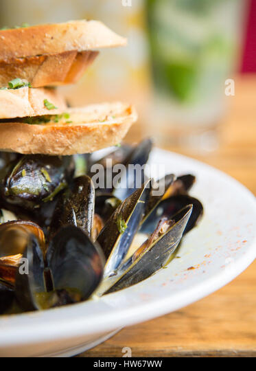 Mussels and bread - Stock Image
