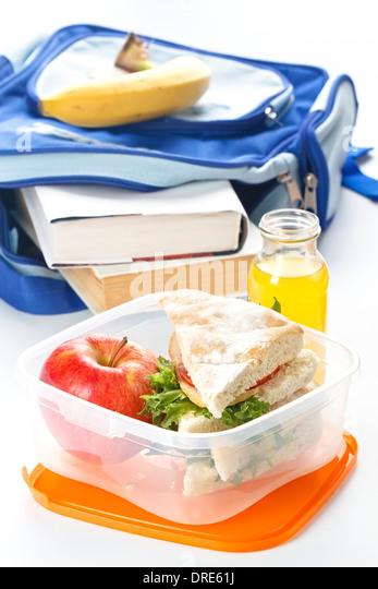 Lunch box with sandwich apple and milk - Stock-Bilder