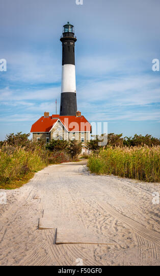 Fire Island lighthouse and house of lighthouse keeper, Bay Shore, Long Island, New York State - Stock Image