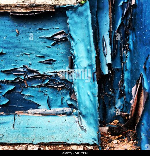 Peeling old blue paint. - Stock Image