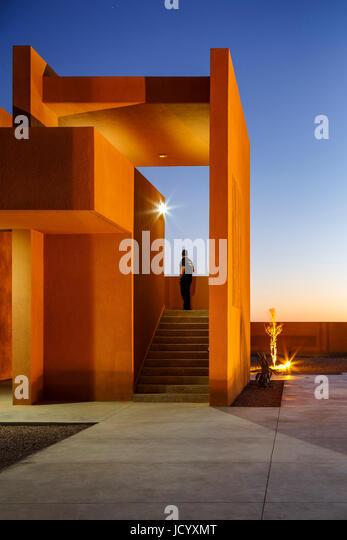 Exterior stairway with figure. Laayoune Technology School, Laayoune, Morocco. Architect: Saad El Kabbaj, Driss Kettani, - Stock-Bilder