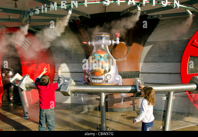 Young children with alien creature at Men In Black Alien Attack attraction at  Universal Studios Orlando Florida - Stock Image