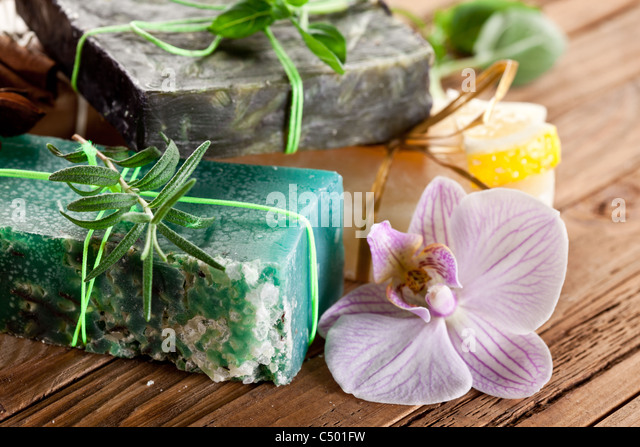 Pieces of natural soap with herbs. - Stock Image