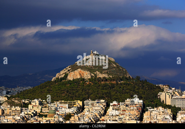 Lycabettus hill, the highest hill of Athens and its best viewpoint, with the church of Saint George on top. Greece - Stock Image
