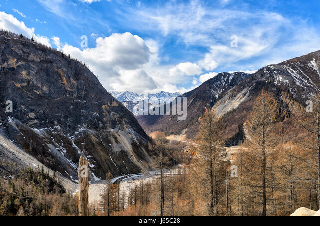 Narrow valley of Irkut River. In background is an array of Munku-Sardyk. Okinsky District. Republic of Buryatia. - Stock Image